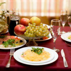 a gourmet restaurant table setting, with entree and appetizer